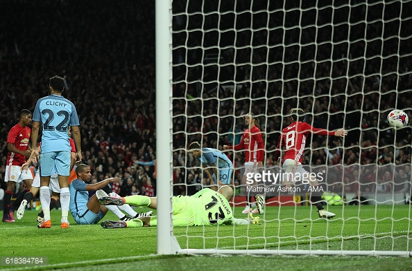 Above: Juan Mat putting the ball into the net during Manchester United's 1-0 defeat of Manchester City | Photo: Getty Images