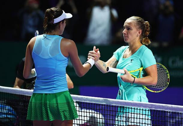 Garbine Muguruza and Svetlana Kuznetsova meet after the Spaniard's three-set win at the WTA Finals last year (Getty/Clive Brunskill)
