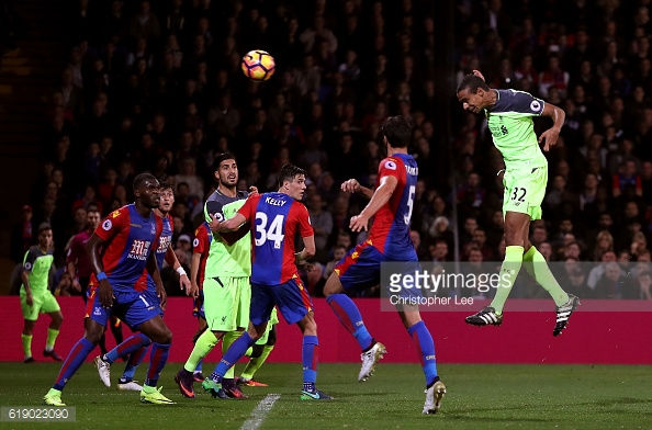 James Tomkins is nowhere near Joel Matip as the defender powers home a header | Photo: Getty images / Christopher Lee