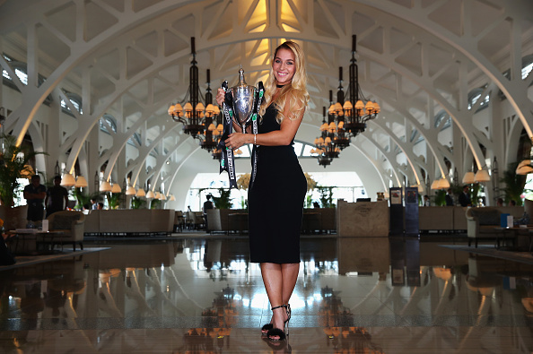 Cibulkova graces Clifford Pier with the trophy during a photoshoot. Photo credit: Clive Brunskill/Getty Images.
