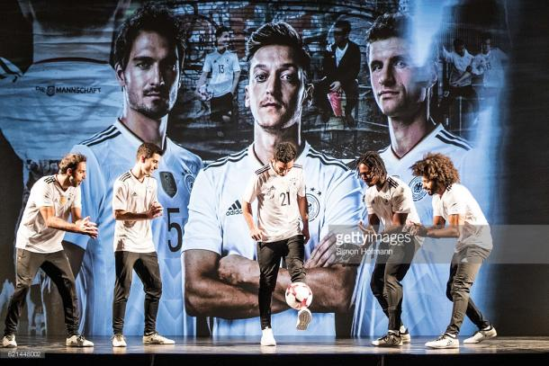 İlkay Gündoğan performs at the ADIDAS launch alongside his Germany teammates. (Photo: Simon Hofmann/Getty Images)