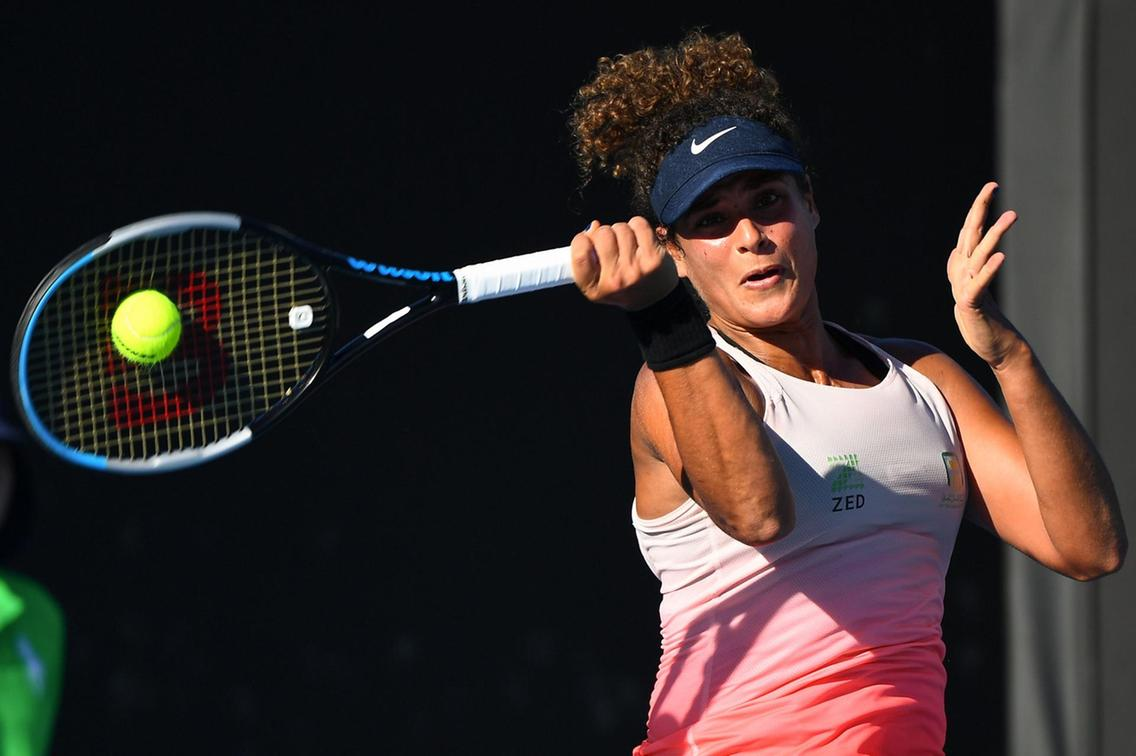 Sherif hits a forehand during her victory over Paquet/Photo: AFP