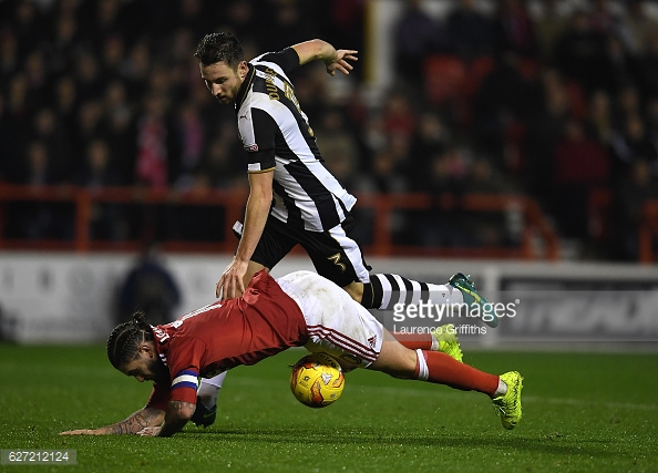 Paul Dummett takes down Henri Lansbury. (picture: Getty Images / Laurence Griffiths)