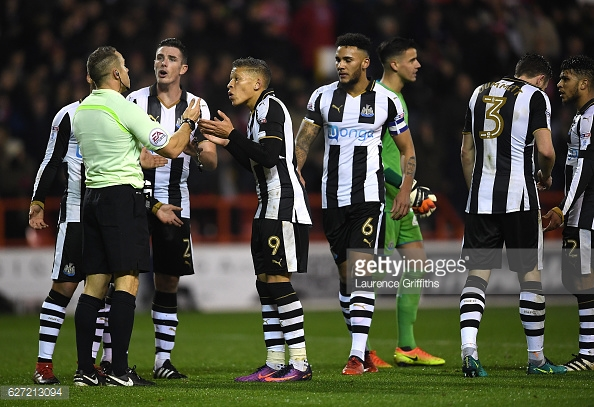 Newcastle players protest after going down to nine men. (picture: Getty Images / Laurence Griffiths)