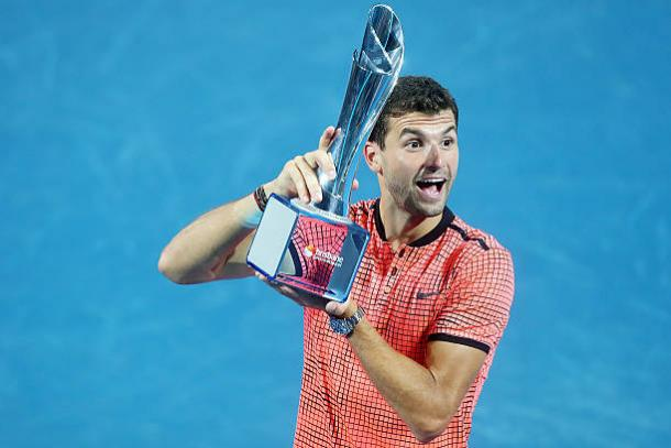 Dimitrov after winning the title in Brisbane (Getty/Chris Hyde)