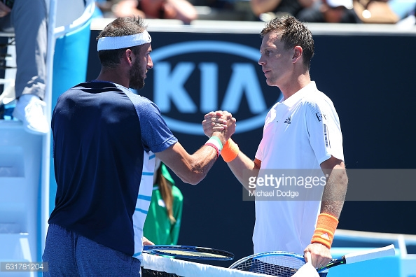 Berdych and Vanni meet at the net following the Italian's retirement from their first round match in Melbourne/Photo: Michael Dodge/Getty Images