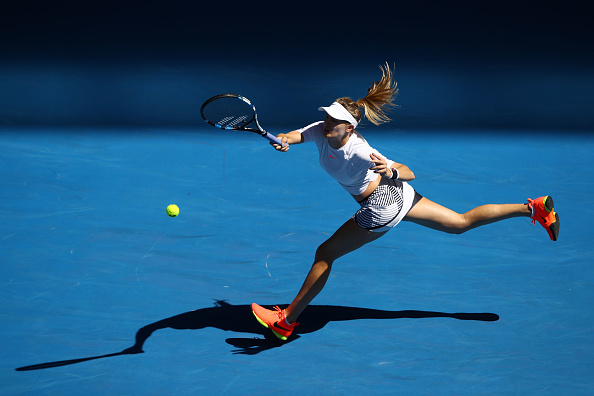 Eugenie Bouchard hits a forehand during her second round match of the Australian Open. (Photo: Getty Images/Clive Brunskill)