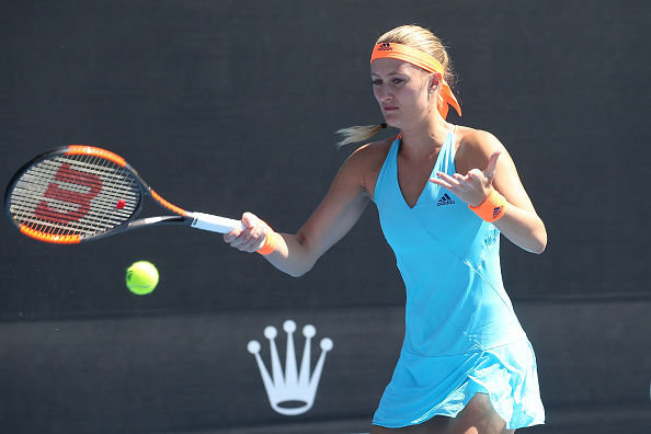 Mladenovic grabs the first set | Photo: Pat Scala/Getty Images