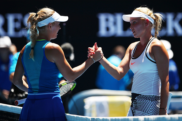 Caroline Wozniacki (L) and Donna Vekic (R) shake hands after their second round match at the Australian Open. (Photo: Getty Images/Clive Brunskill)