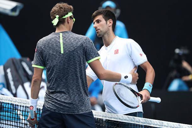 Djokovic congratulates Istomin following his Australian Open loss (Getty/Scott Barbour)