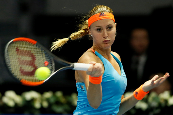 Mladenovic gets the late crucial break | Photo: Mike Kireev/NurPhotos via Getty Images