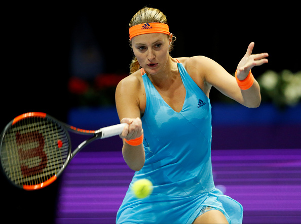Mladenovic serves her way to take the first set | Photo: Mike Kireev/NurPhotos via Getty Images