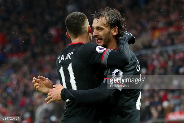 Tadic celebrates with his teammate after assisting. (Source: GettyImages)