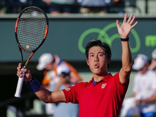 Kei Nishikori waves to the crowd after his quarterfinal win over France's Gael Monfils/Erik A. Lesser/Associated Press