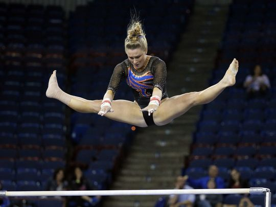 Bridget Sloan performs on the uneven bars at the NCAA Women's Gymnastics Championships/AP