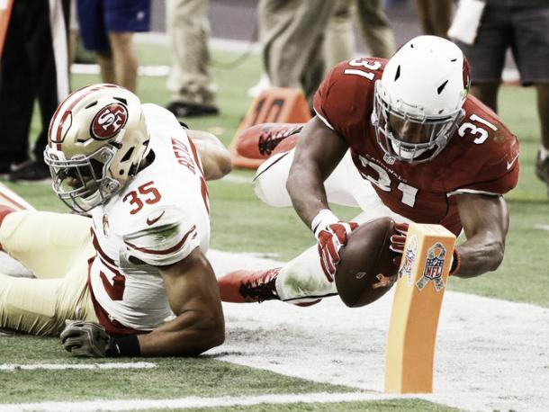 David Johnson dives for the pylon as he scores a touchdown against the San Francisco 49ers |Source:Chris Coduto/Getty Images North America |
