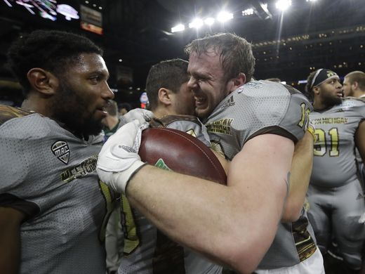 Western Michigan linebacker Robert Spillane (r.) is congratulated by his teammates after intercepting Ohio on the final drive of the game/Photo: Carlos Osorio/Associated Press