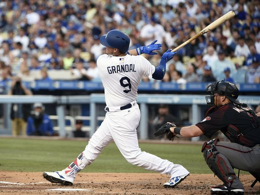 Yasmani Grandal hits and RBI double to give the Los Angeles Dodgers a 1-0 lead. Jul 5, 2017. |Source:Kelvin Kuo-USA TODAY Sports|