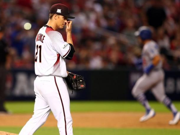 Diamondbacks starting pitcher Zack Greinke (21) reacts after giving up a solo home run to Dodgers catcher Austin Barnes (15) in the sixth inning. | Source – Mark Rebilas/USA TODAY Sports|