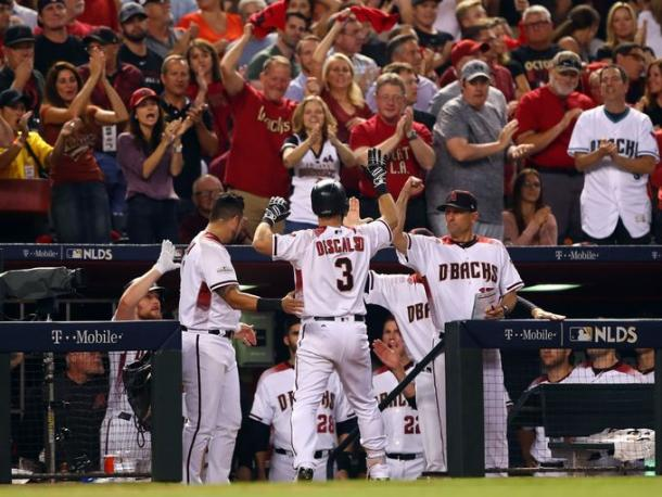 Daniel Descalso (3) is greeted by manager Tory Lovullo (17) after hitting a home run in the fifth inning. |Source – Mark Rebilas/USA TODAY Sports|