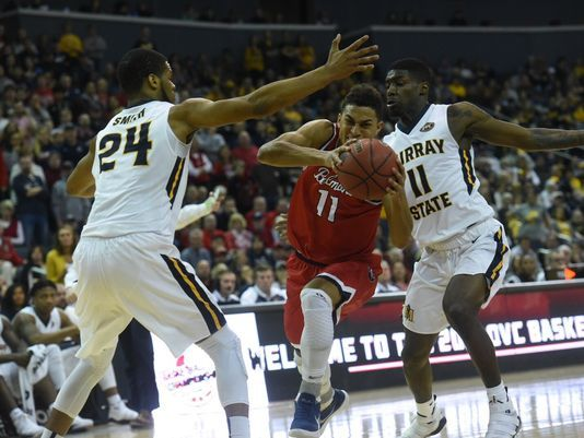 Kevin McClain tries to drive between two Murray State defenders during the OVC title game/Photo: Sam Simpkins/Belmont University