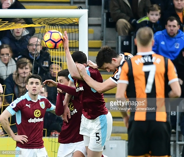 Keane handles inside the area to give away a penalty/Photo; Chris Vaughan/CameraSport via Getty Images