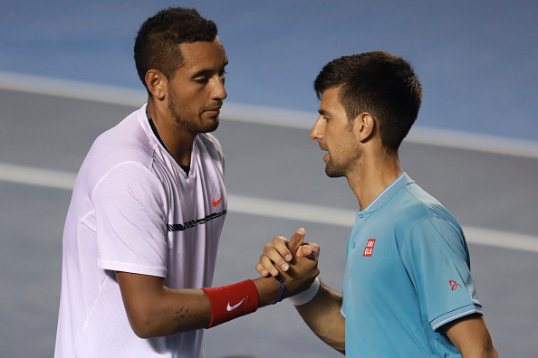 Novak Djokovic and Nick Kyrgios after their quarterfinal match. (Photo: Getty Images/Miguel Tovar/STF)
