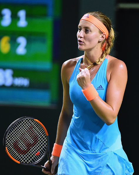 Mladenovic eventually breaks for the set   Photo: Harry How/Getty Images