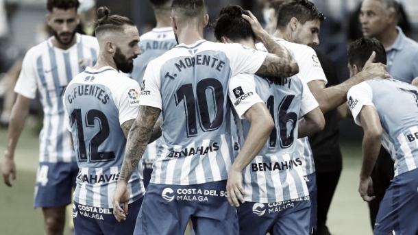 Jugadores del Málaga CF celebrando la permanencia en el partido disputado contra el Alcorcón la pasada jornada. / Foto: Málaga CF