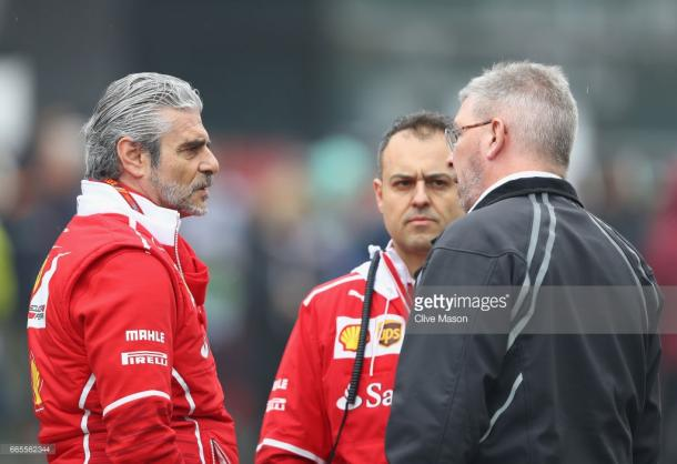Maurizio Arrivabene (L) chats with Ross Brawn (R). | Photo: Getty Images/Clive Mason