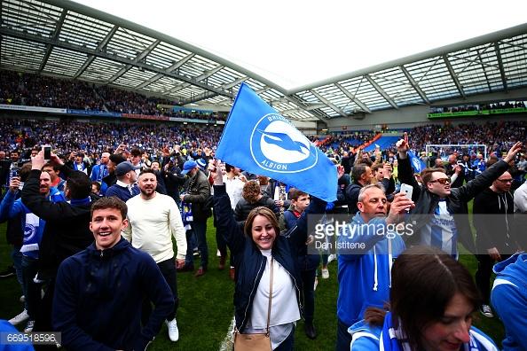 Brighton fans celebrate promotion to The Premier League. (picture: Getty Images / Dan Istitene)