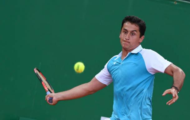 Spain's Nicolas Almagro hits a return to Belgium's David Goffin during their Monte-Carlo ATP Masters Series tournament tennis match on April 18, 2017 in Monaco. (Photo by AFP PHOTO / Yann COATSALIOU)