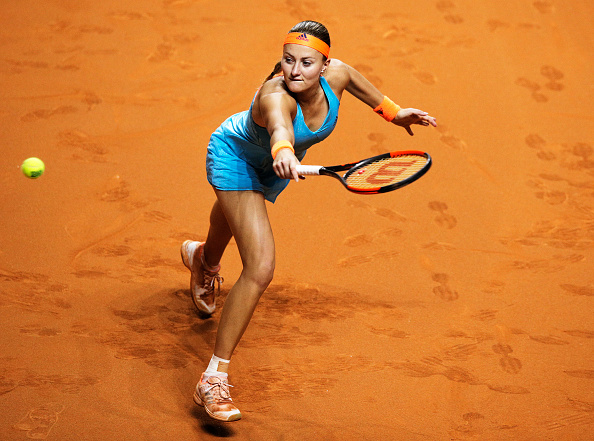 Mladenovic forces the decider with a break at the end | Photo: Adam Pretty/Bongarts/Getty Images