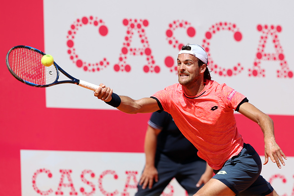 Joao Sousa of Portugal returns a ball to Bjorn Fratangelo of US during the Millennium Estoril Open 1st round tennis tournament in Estoril, outskirts of Lisbon, Portugal on May 2, 2017. Bjorn Fratangelo of US won 6-3, 6-4. (Photo by Pedro Fiúza/NurPhoto via Getty Images)