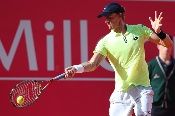 Kevin Anderson from South Africa in action during the match between Gilles Muller From Luxembourg and Kevin Anderson from South Africa for Millennium Estoril Open at Clube de Tenis do Estoril on May 6, 2017 in Estoril, Portugal. (Photo by Carlos Rodrigues/Getty Images)