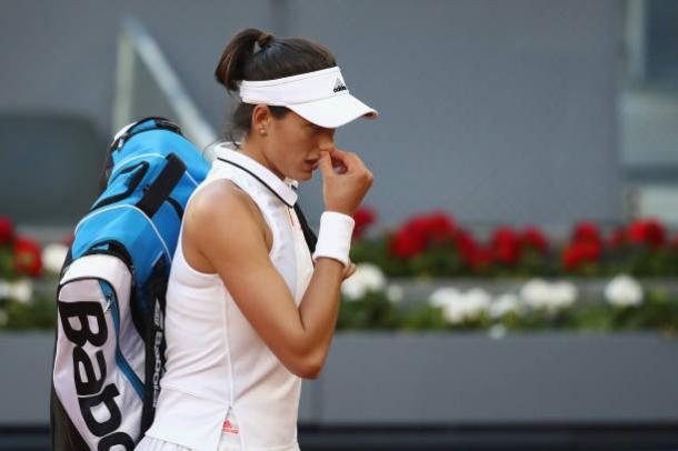 Muguruza walks off court following her loss to Timea Bacsinszky in Madrid (Getty/Julian Finney)