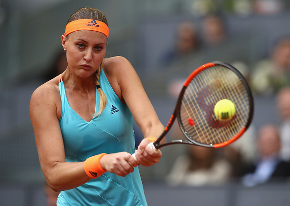 Mladenovic has the chance to serve for the set | Photo: Julian Finney/Getty Images