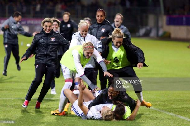 Hegerberg is mobbed by her teammates after scoring the winning penalty in the CdF final (Credit: Getty/Icon Sport)