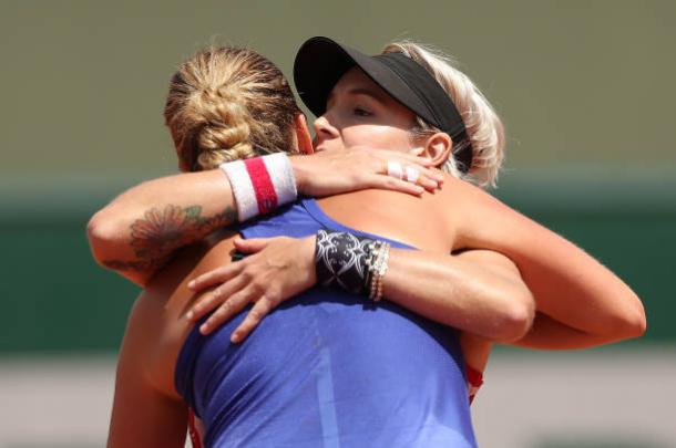 Mattek-Sands hugs Kvitova after the conclusion of their match at the French Open. Photo credit: Ian MacNicol/Getty Images.