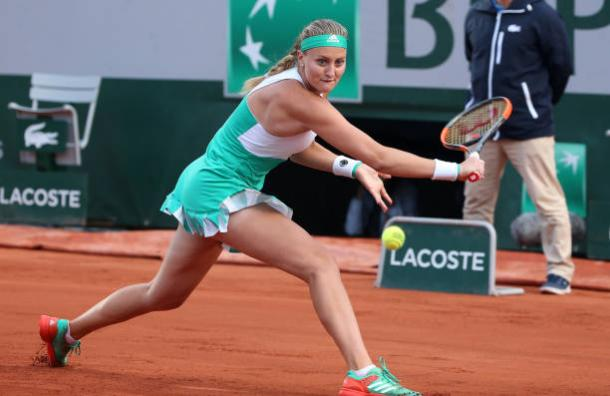 Mladenovic slides on the clay during the quarterfinal of the French Open last week. Photo credit: Jean Catuffe/Getty Images.