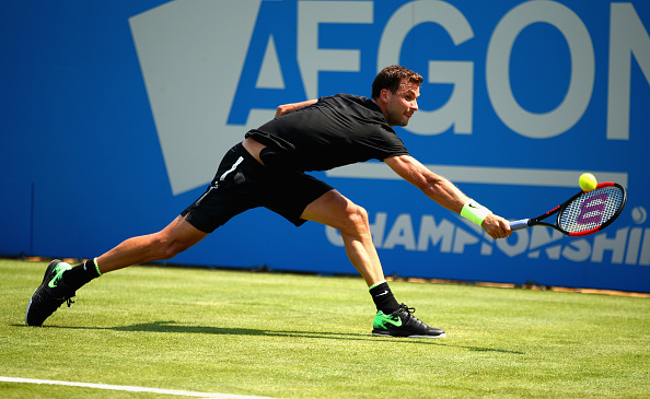 Grigor Dimitrov stretches for a shot (Photo: Clive Brunskill/Getty Images)