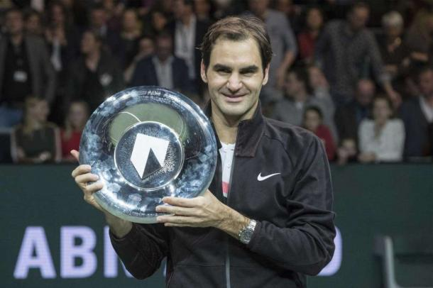 Roger Federer hoists the trophy in Rotterdam, capping off a dream week. Photo: Patrick Post/AP