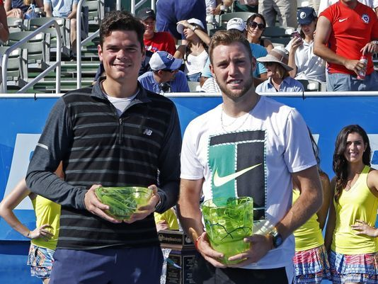 Jack Sock (right) was gifted the Delray Beach title last year when Milos Raonic (left) withdrew. Photo: Joel Auerback/AP