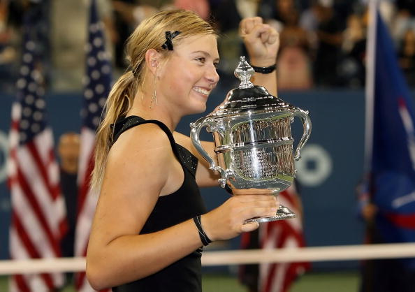 Maria Sharapova celebrates winning her first US Open title in 2006. (Getty Images/Clive Brunskill)