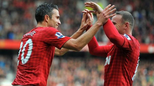 Van Persie and Rooney celebrate a goal for Manchester United (Source: Andrew Yates / AFP)