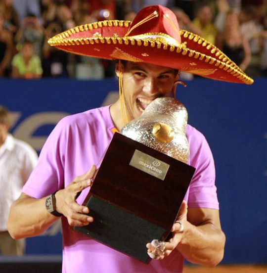 Rafael Nadal chows down the Acapulco trophy after his most recent victory back in 2013. He lost in the 2014 final to his potential quarterfinal opponent, Sam Querrey. Photo: Abierto Mexicano Telcel