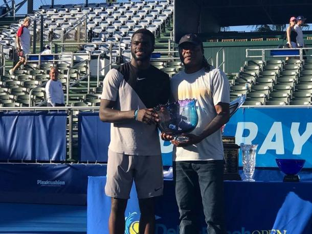 Frances Tiafoe (left) and his dad pose with the American's first ATP World Tour trophy. Photo: Delray Beach Open