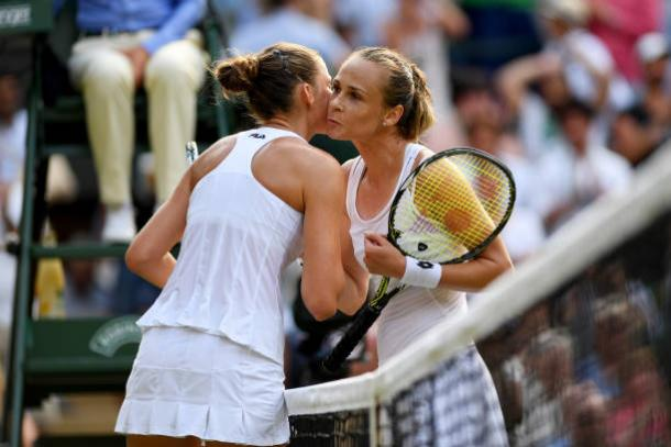 Karolina Pliskova and Magdalena Rybarikova embrace after their match (Getty/Shaun Botterill)