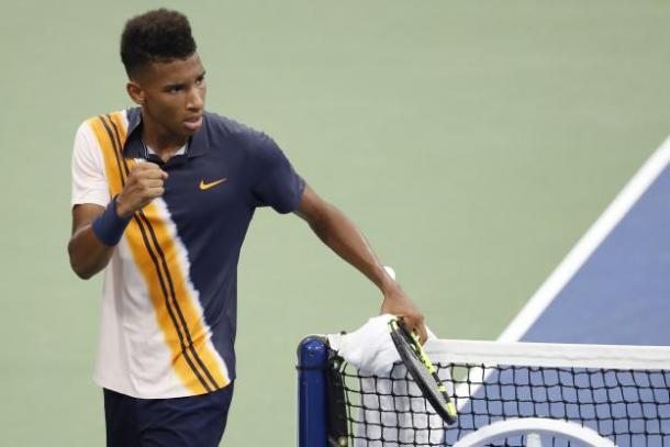 Félix Auger-Aliassime celebrates after winning a point during his first-round match against Denis Shapovalov at the 2018 U.S. Open. | Photo: Reuters