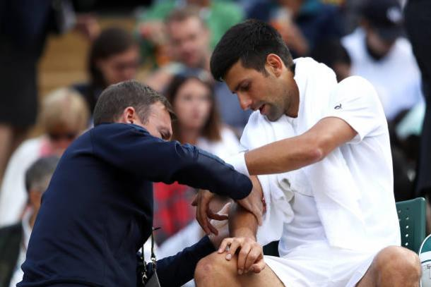 Djokovic was forced to retire from Wimbledon due to his elbow injury (Getty/Julian Finney)